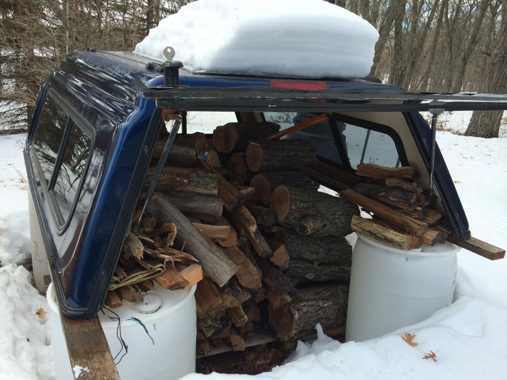 the truck topper woodshed kept the firewood snug & dry