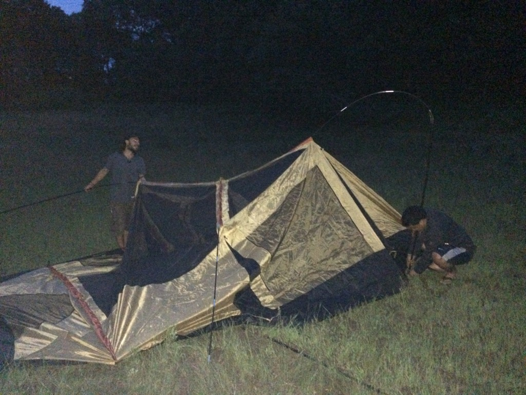 Sean helping Leonel set up his tent for the first time, in the dark