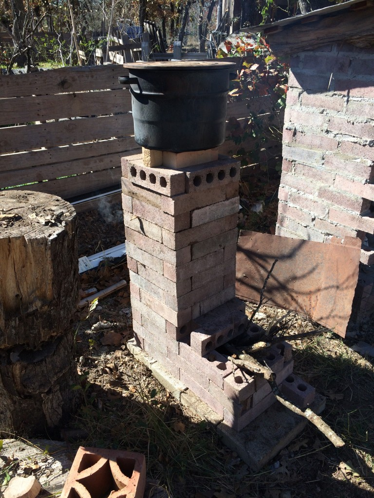 of course we had to build them a rocket stove (this one is for boiling pots of water to dunk chickens in for plucking)