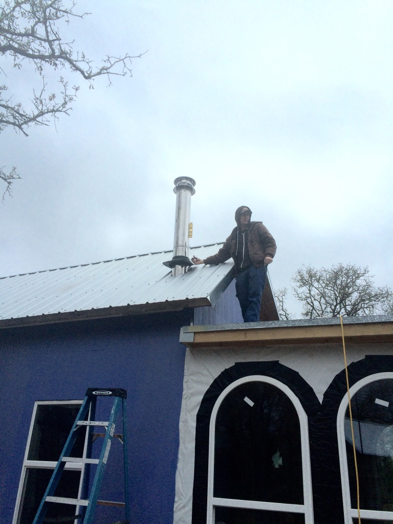 Shane putting the finishing touches on the new woodstove chimney (oops this pic is actually from the last days of December)