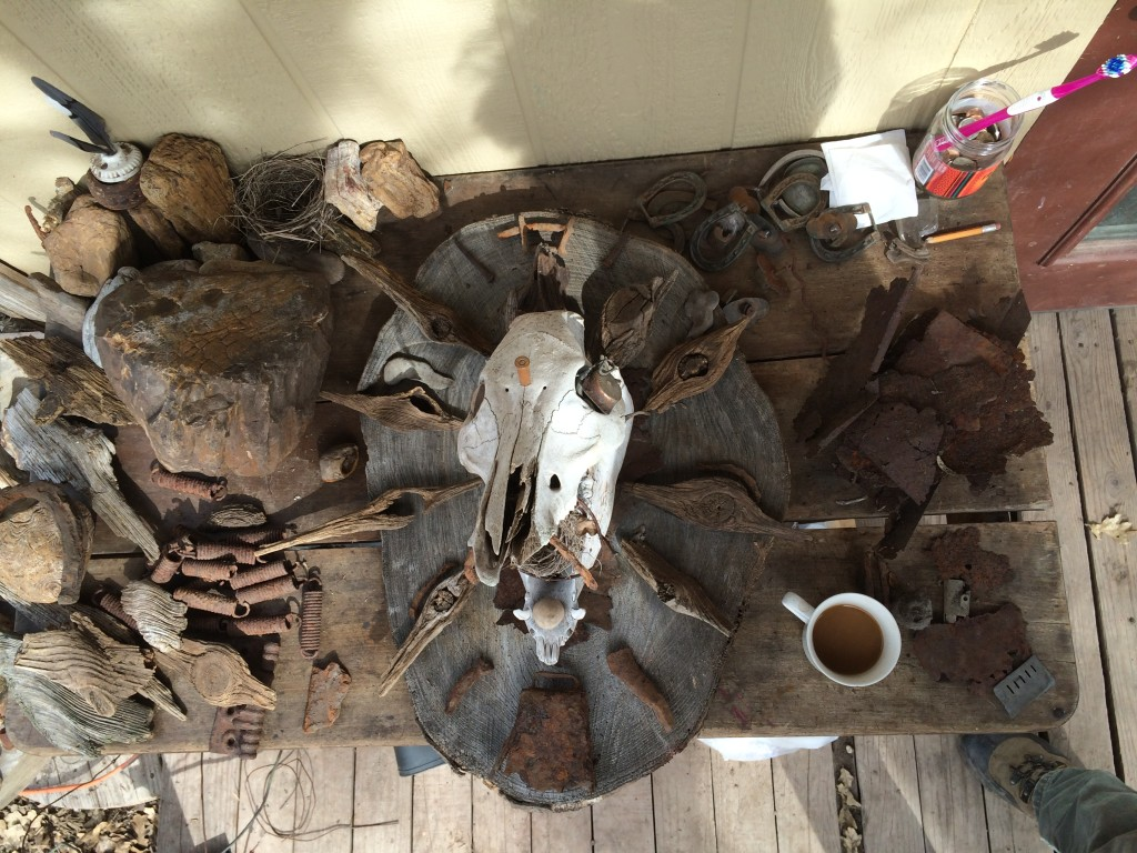 rocks and artifacts and bones outside the cabin