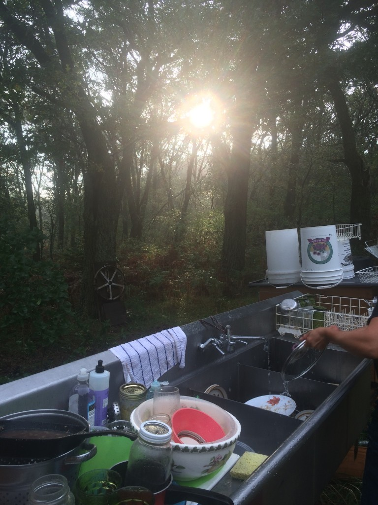 doing dishes at sunset