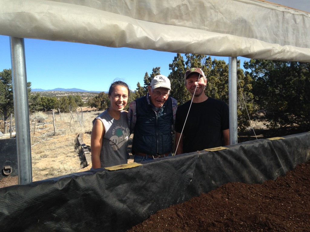 otherWWOOFer Ali, Dee Word (89 years old & always working harder than anyone), and Gabe finishing up the filling of the new raised grow bed
