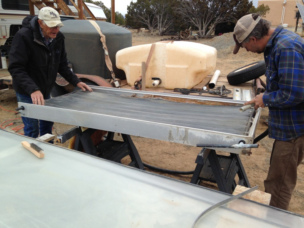 refurbishing solar thermal panels with Dee - these use copper piping and fins to heat fluid as it flows through