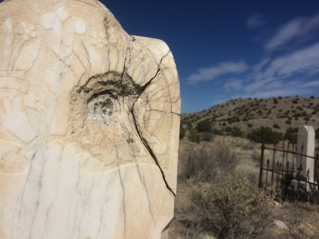 gunshot gravestone in the old Los Cerrillos cemetary