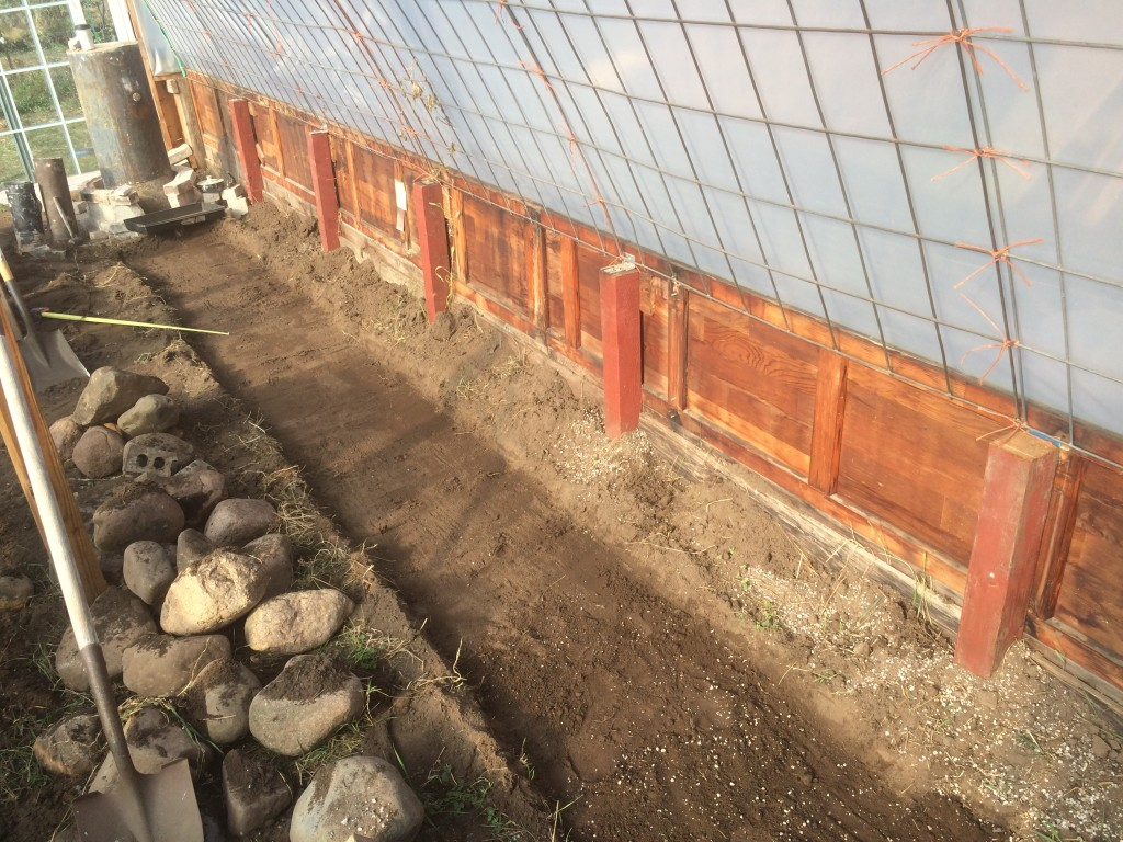 trench for thermal mass foundation/insulation layer