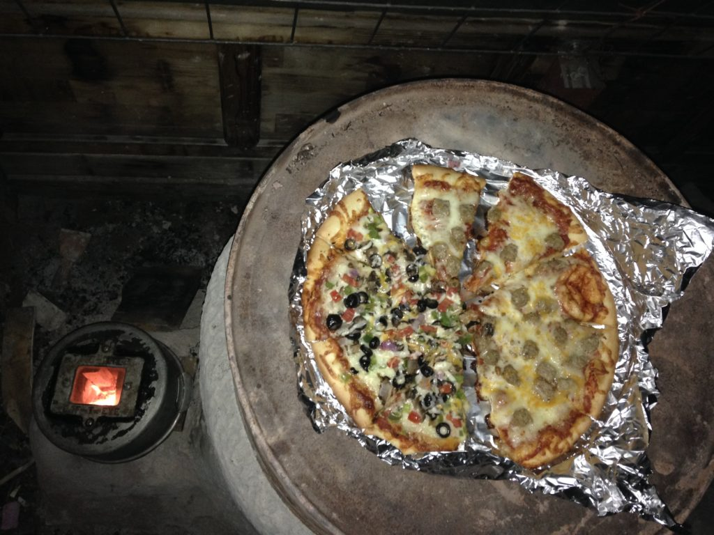 reheating and crisping leftover pizza while firing the mass for the night