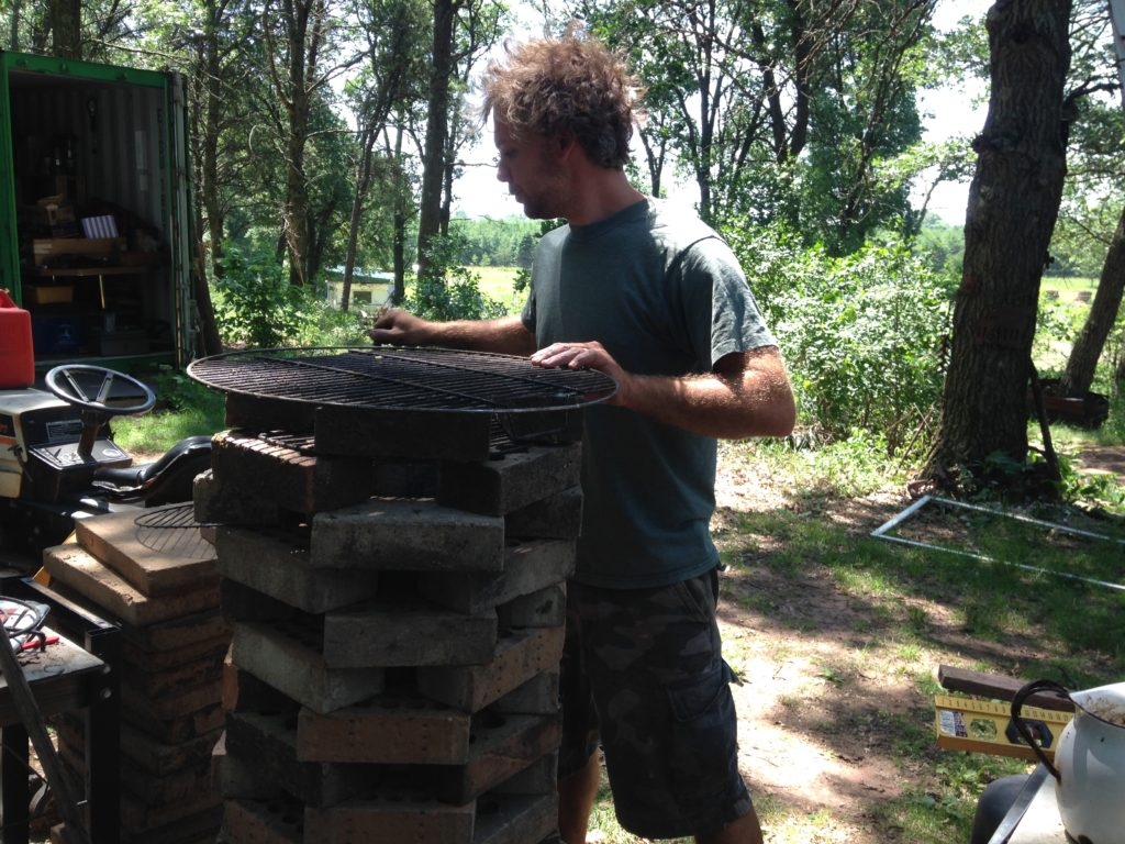 rebuilding the rocket stove grill that the bear destroyed