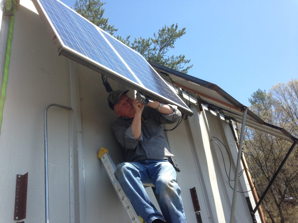 Jim helps install the new solar panels