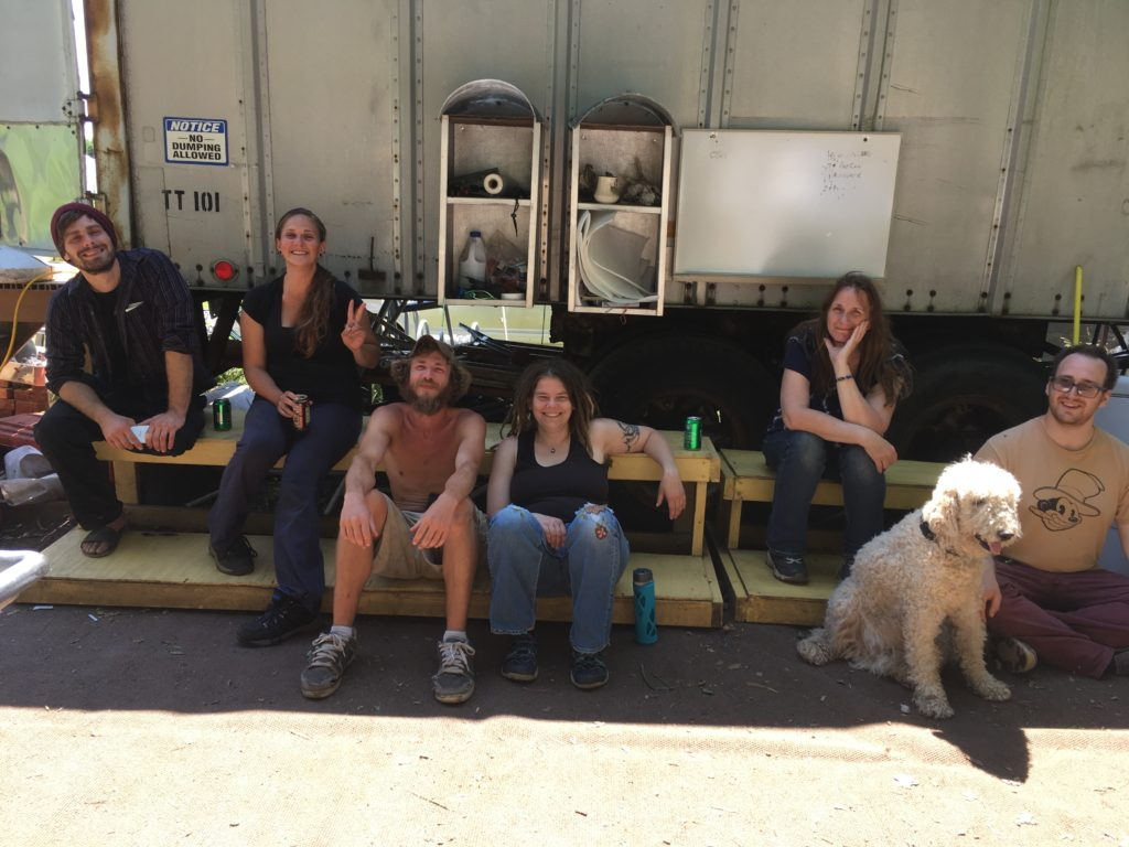 part of the CSA harvest crew relaxing after all the boxes were loaded up