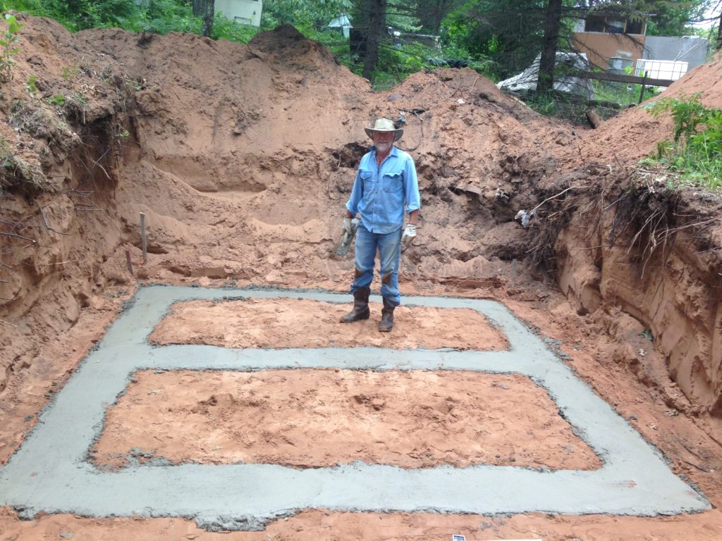 Gabe's Dad spent a few days at the farm and helped lead up the project to build the root cellar foundation properly