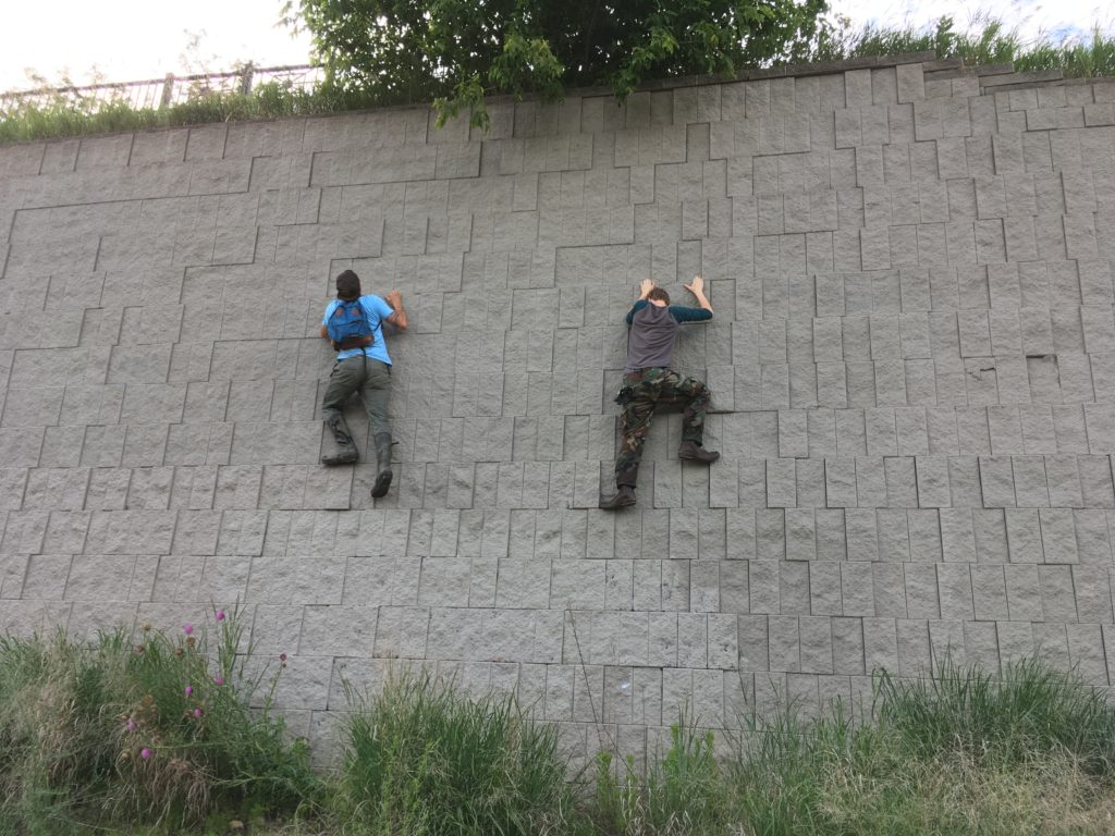 CSA Members Aaron & Robby scale a wall, because it was there.