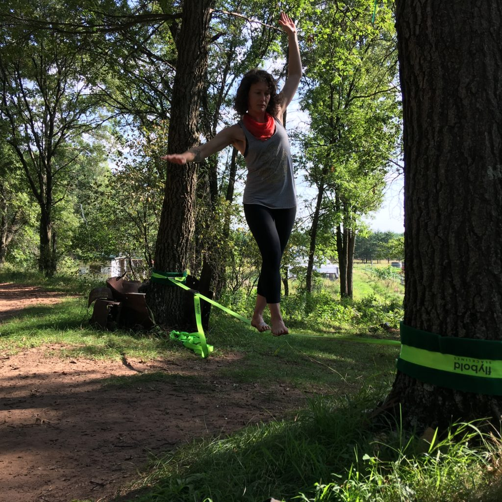 shareholder Tara brought a slack line to the farm for us to play with. Now I'm sore.